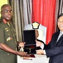 Ambassador of the PRC to Guyana, Mr. Cui Jianchun performs a ceremonial handing over of keys to Chief of Staff of the GDF