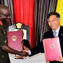 Ambassador of the PRC to Guyana, Mr. Cui Jianchun performs ceremonial handing over of documents to Chief of Staff of the GDF